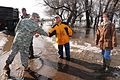 A US Army soldier shakes hands with a resident in rural Kindred, ND.jpg