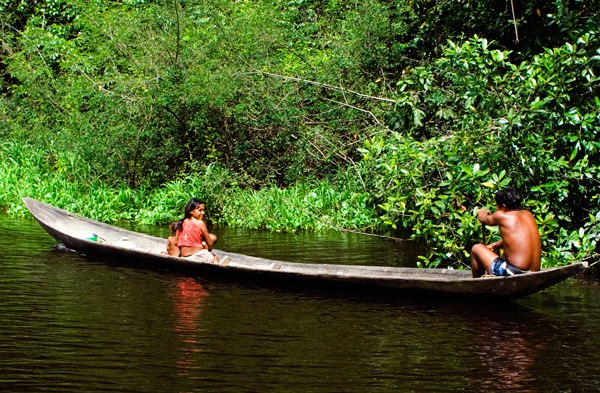 A Warao family in their canoe