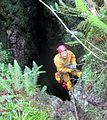 A caver descending Death's Heads Hole entrance shaft.JPG