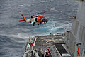 A crew aboard an MH-60 Jayhawk helicopter from Coast Guard Air Station Elizabeth City, N.C., lands aboard the guided missle destroyer USS Ross, Jan. 14, 2014 140114-G-ZZ999-003.jpg