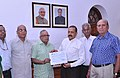 A delegation of Bharat Pensioners' Samaj handing over donation to Prime Minister's National Relief Fund for J&K flood victims to Minister of State for Science & Technology (IC), Earth Sciences (IC), Prime Minister Office.jpg