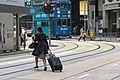 A lady hurrying towards Ice House Street tram stop (20190121091803).jpg