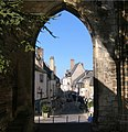 A square in La Charité-sur-Loire thru an Arch ruin from Notre Dame - panoramio.jpg