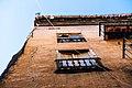Abandoned building facade (Unsplash).jpg