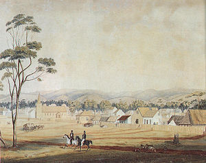 "North Terrace, Adelaide - Adelaide in 1839 as viewed south-east from the western end of North Terrace, including Holy Trinity Church. (The church tower lost its ""peaked cap"" in 1844.)"