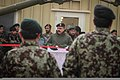 Afghan National Army Brig. Gen. Mohammed Akyam Sameh, center, the commander of the 2nd Brigade, 205th Corps, speaks during a ribbon-cutting ceremony marking the opening of the Regional Artillery Training Center 131230-Z-HP669-003.jpg