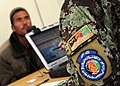 Afghan National Army recruit provides information to a biometric system.jpg