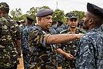 Air Chief Marshal Kolitha Gunathilake pins the Sri Lankan Marine Corps emblem onto a Sri Lankan Marine.jpg