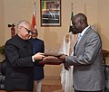 Ajay Kumar Sharma exchanging the Memorandum of Understanding on Cultural Exchange Cooperation with his Malian counterpart, following the delegation level talks between the Vice President.jpg