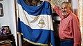 Alfonso Robelo holds up a Nicaraguan flag.jpg
