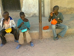 Mendicant -  Almajiri Mendicants eating food they received through donation