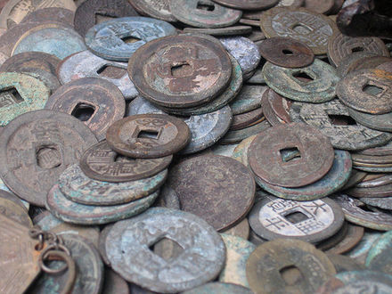 Traditional holed Chinese coinage is also known as cash Ancientchinesecoins.jpg