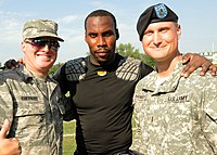 Anquan Boldin with US Army soldiers in 2010.jpg