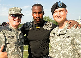Anquan Boldin - Boldin (center) with service members of the US Armed Forces while with the Ravens in 2010 at McDaniel College