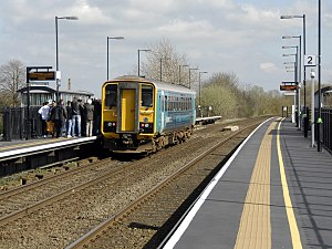 Cosford railway station - Arriva Trains Wales train pauses to collect passengers on a Sunday service at Cosford