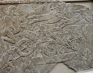 Military history of the Neo-Assyrian Empire - Assyrian army crosses a river, probably Euphrates. Some soldiers are swimming while others are loading chariots on to a boat. Reign of Ashurnasirapl II, 865–860 BC, from Nimrud, Iraq, currently housed in the British Museum