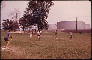 Sewaren, New Jersey - Baseball in Ferry Street Park, with Shell Oil's tank farm in the background, 1973