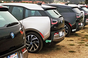 Plug-in hybrids in California - Several BMW i3s with California's HOV lane access stickers. The i3 with range-extender has the green sticker while the pure electric i3 displays the white sticker.