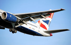 Navigation light - A British Airways Boeing 757-200 lands. The port wing tip carries a red navigation light.