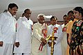 Bandaru Dattatreya lightening the lamp at the inaugural event of the 'Career Counseling and Skill Development for Youth', in Hyderabad on April 12, 2015.jpg