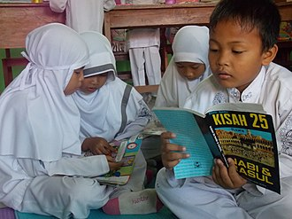 Islam Nusantara - Compared to their Middle Eastern counterparts, Indonesian Islam has a more relaxed view and a moderate outlook. They do not practice sex segregation in public spaces, as shown here boys and girls students are studying together in their classroom.