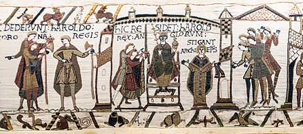 Coronation of Harold II of England at Westminster Abbey in 1066. From the Bayeux Tapestry. Bayeux Tapestry scene29-30-31 Harold coronation.jpg