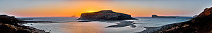 Gramvousa - Sunset at the Balos Lagoon with Cape Tigani in the center, Pondikonisi in the background to the left, the island of Imeri Gramvousa in the background to the right, and further back to the right is the island of Agria Gramvousa (panoramic photograph taken from the island of Crete).