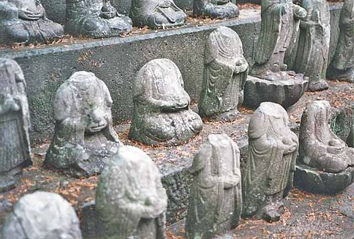 Buddhist statues of Jizo, the bosatsu of mercy, beheaded by rebelling Christians. BeheadedJizo.jpg