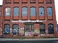 Biermannstraße 16, Celle, Gebäude der ehemaligen Celler Lederwerke, Aufschrift Coca Cola Franz Miecke KG, Stahlbuchstaben CVS sowie Schmierereien.jpg