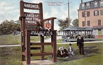"""Gardner station - The """"Biggest Chair"""" at Gardner station around 1910"""