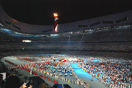 Athletes gather in the stadium during the closing ceremony of the 2008 Summer Olympics in Beijing. Birdsclosing.jpg