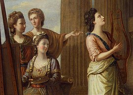 Detail from a painting, showing four women dressed in classical-inspired costumes in front of a pillar