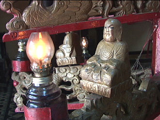 Giác Lâm Pagoda - This little contemplative figure is part of a large candle-holder, in which each candle is faced by such a figure.
