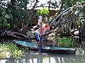 Boy in canoe holding a turtle - Guatemala.jpg