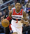 Bradley Beal is playing for the Washington Wizards dribbling a ball down the court