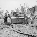 British troops examine a knocked-out German StuG III assault gun near Cassino, Italy, 18 May 1944. NA15178.jpg