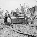 British troops examine a knocked-out German StuG III assault gun near Cassino, Italy, 18 May 1944. NA15178.jpg