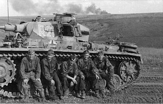 Panzer III - The crew of a Panzer III of the 2nd SS Panzer Division ''Das Reich'' rest during the Battle of Kursk.