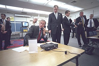 President George W. Bush is briefed on the attacks in Sarasota, Florida. Bush 9-11 on phone.jpg