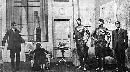 A scene from Karel Capek's 1920 play R.U.R. (Rossum's Universal Robots), showing three robots Capek play.jpg