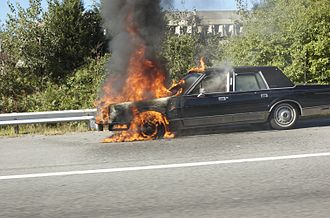 Vehicle fire - A car engine fire on the Massachusetts Turnpike.