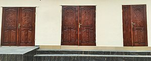 Nsibidi - Contemporary Igbo art: carved mahogany doors covered in nsibidi symbolism and Christian iconography in Aba, Nigeria
