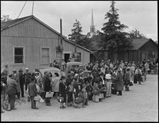 Centerville, California. Members of farm families await evacuation bus. Farmers and other evacuees . . . - NARA - 537574