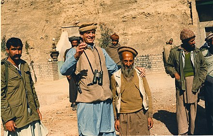 Charlie Wilson (D-TX), 2nd from the left, dressing in Afghan clothing (armed with AK-47) with the local Afghan mujahideen. Charlie Wilson with Afghan man.jpg