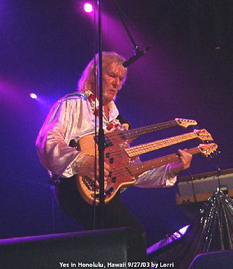 Multi-neck guitar - Chris Squire of Yes (2003) playing Wal triple-neck bass consists of 3 double-course guitar, fretted and fretless 4-string basses.