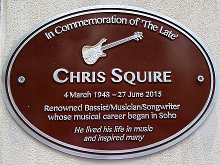 Brown plaque in Warwick Street, Soho, London Chris Squire Brown Plaque with Rickenbacker 4001 bass guitar motif.jpg