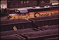 Closeup of a Railroad Engine and Coal Cars Loaded for Shipment to Customers at the Danville, West Virginia, near Charleston 04-1974 (3907196970).jpg