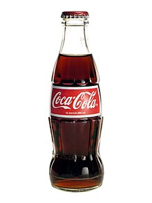 characteristically shaped Coca-Cola bottle.