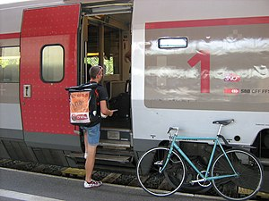 Bicycle messenger - Bicycle courier transferring urgent mail onto a high-speed train in Geneva, Switzerland.