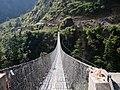 Crossing the Suspension Bridge below Ghasa, Nepal.jpg